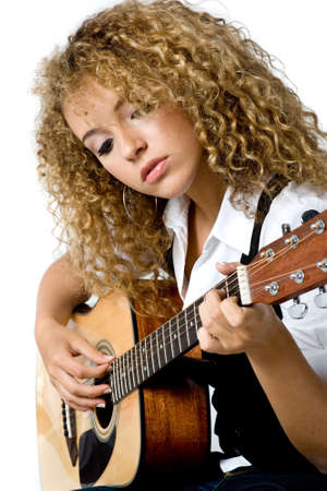 talented: A pretty young woman playing acoustic guitar on white background
