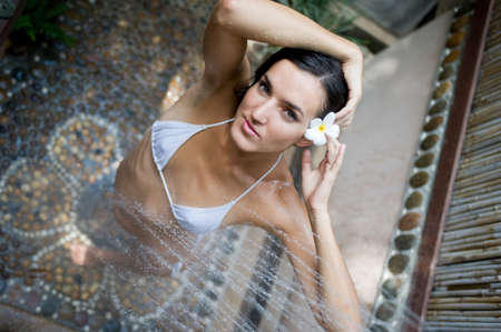 A young woman showering outside Stock Photo - 2634963