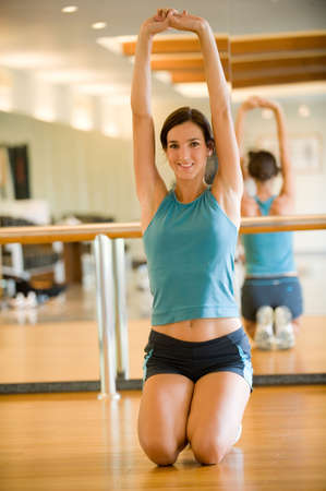 A woman stretching in the gym Stock Photo - 2645732