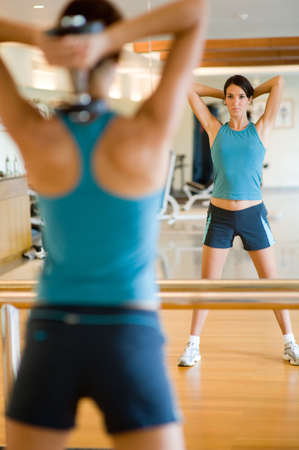 A young attractive woman working out in gym