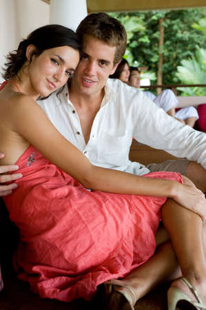 A young couple sitting together in a resort Stock Photo - 2668426