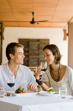 A young couple sitting together in a restaurant