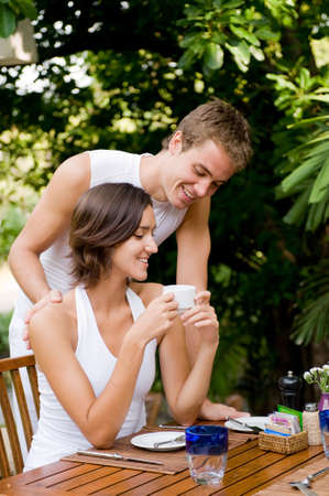 A young couple together at breakfast at a tropical resort