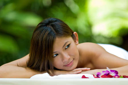 A beautiful young asian woman ready for spa treatment