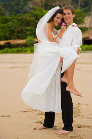 A young couple just married on the beach photo