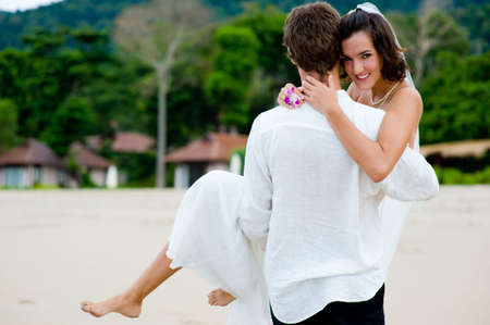 A young couple just married on a tropical beach Stock Photo - 2752179