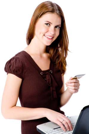 card making: A young attractive woman with laptop and credit card making online purchase Stock Photo