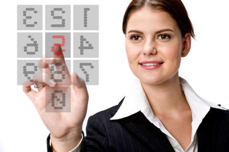 A young businesswoman typing on a transparent keypad on screen Stock Photo