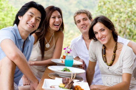A group of young adults having lunch on vacation photo