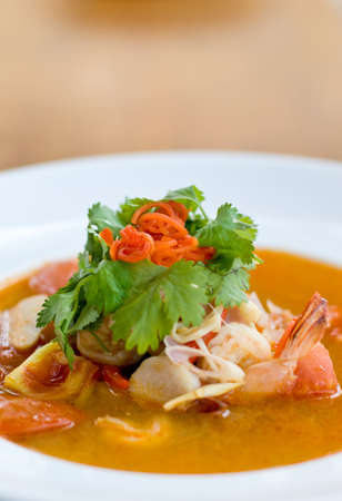 yum: A bowl of fresh tom yum soup, a spicy thai dish Stock Photo