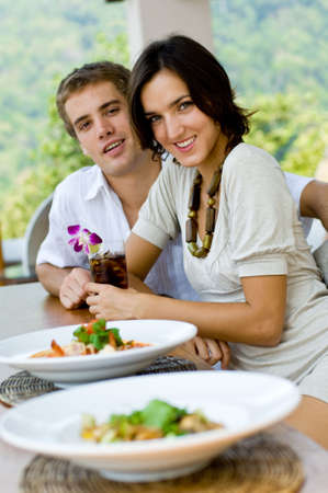 A young couple on vacation eating lunch at a relaxed outdoor restaurant Stock Photo - 2898006