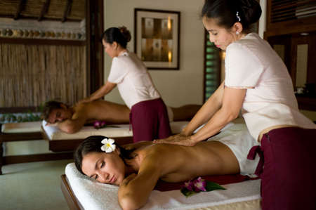 thai massage: A young couple receiving massage treatments together