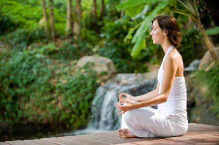 A young woman practising yoga outside Stock Photo - 2941043
