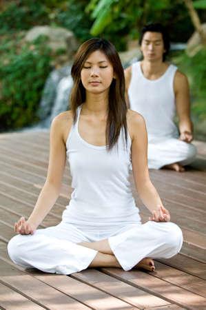 A young couple doing yoga outside