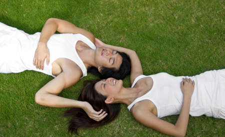 A young couple lying together on vacation photo