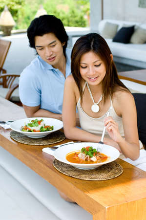 A young Asian couple enjoying lunch oudoors photo