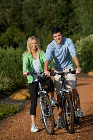 A young couple on bicycles in the countryside Stock Photo - 3113045