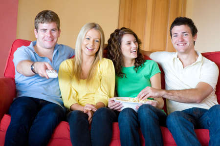 Four young adults having fun at home Stock Photo - 3175513