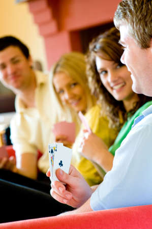 Four friends playing poker at home Stock Photo - 3175510