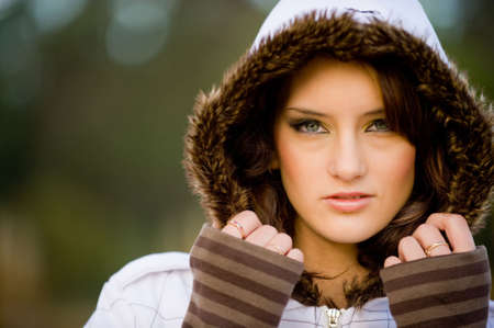 A beautiful young woman in a winter coat outside Stock Photo