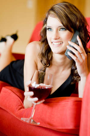 A young attractive woman relaxing on sofa at home photo