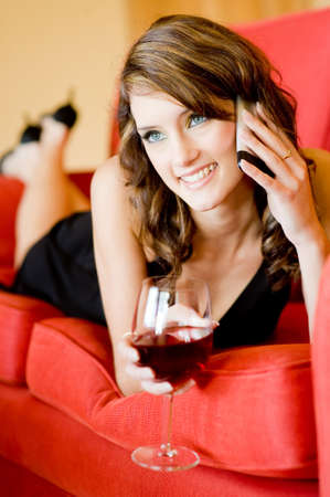 A young attractive woman relaxing on sofa at home Stock Photo