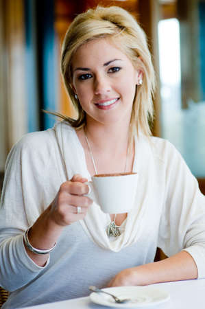 A young attractive woman with coffee in a restaurant Stock Photo - 3200356