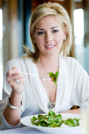 A young attractive woman having a healthy lunch Stock Photo - 3200373