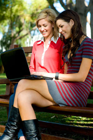 Two young attractive women studying together at college Stock Photo - 3200377