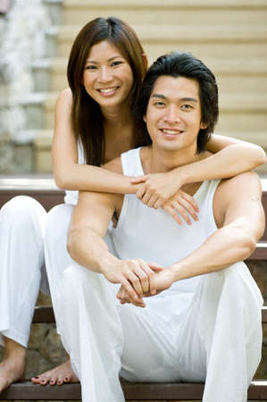 A young couple sitting together on vacation photo