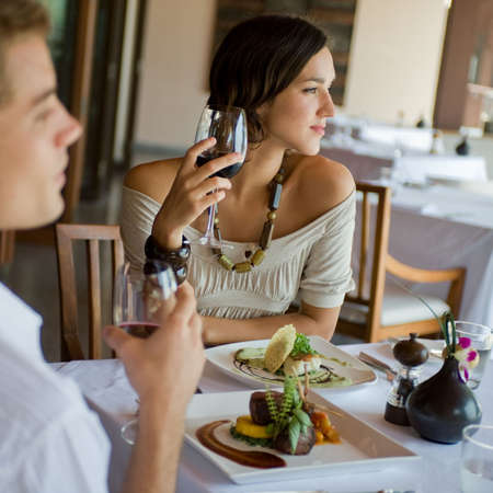 to refine: A young couple having dinner at a restaurant