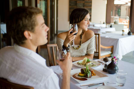 expensive food: A young couple having dinner at a restaurant