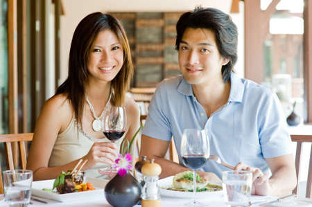 couple dining: A young Asian couple having dinner at a restaurant