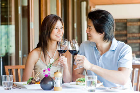 A young Asian couple having dinner at a restaurant
