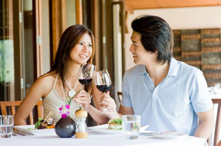 A young Asian couple having dinner at a restaurant photo