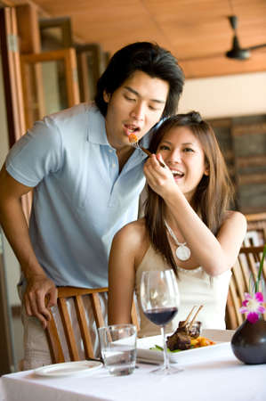 A young Asian couple having dinner at a restaurant Stock Photo - 3220947