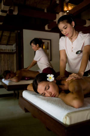 A young couple receiving massage treatments together photo