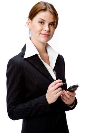 A young attractive businesswoman holding a handheld device on white background Stock Photo
