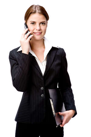 A young businesswoman on the phone holding a folder photo