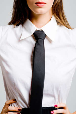 A young sexy businesswoman in blouse and tie