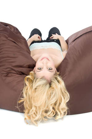 upside down: A young attractive woman lying down