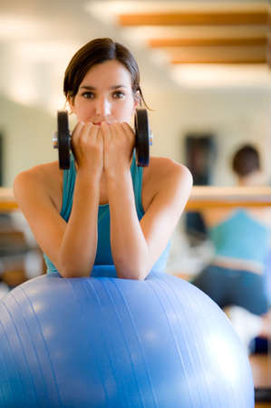 A young woman working out in a gym Stock Photo - 3564847
