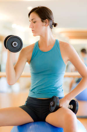 A young woman working out in a gym Stock Photo