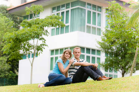 A young couple sitting in garden of their house Stock Photo - 3708469