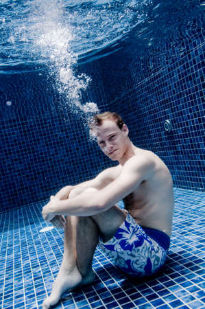 An underwater shot of a man in a swimming pool Stock Photo