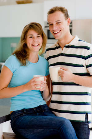 A young attractive couple at home in the kitchen photo