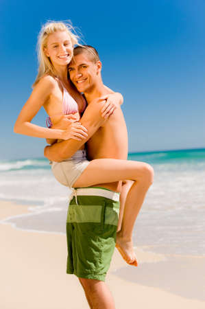A couple on holiday at a beautiful beach Stock Photo