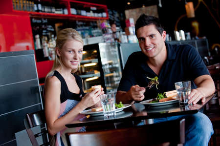 A young attractive couple sitting together in a cafe photo