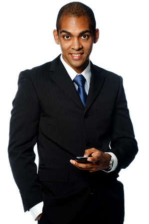A confident young black businessman with mobile phone on white background Stock Photo - 4370136
