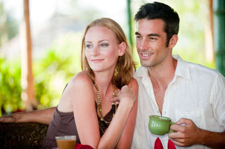 A young couple enjoying breakfast whilst on vacation